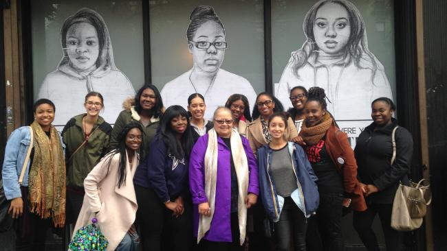 A group of people pose at the Black Girl Movement Conference